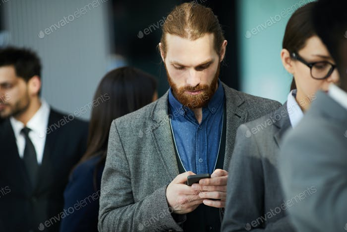 Businessman waiting in line