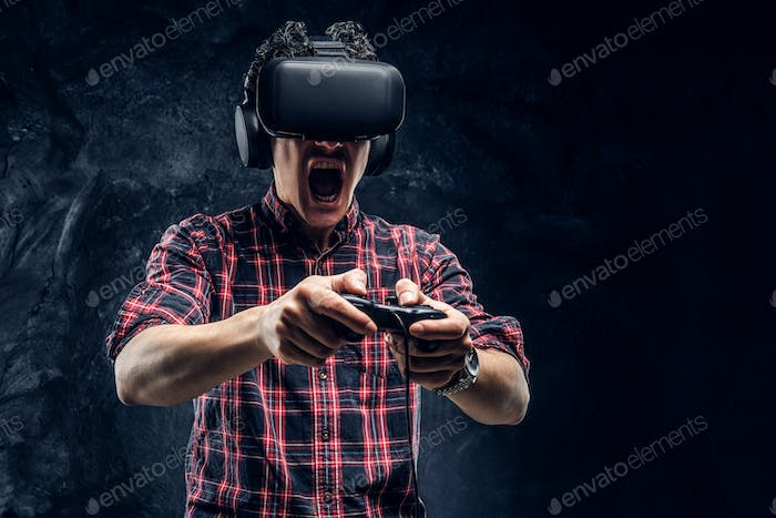 Teenager plays the game wearing virtual glasses