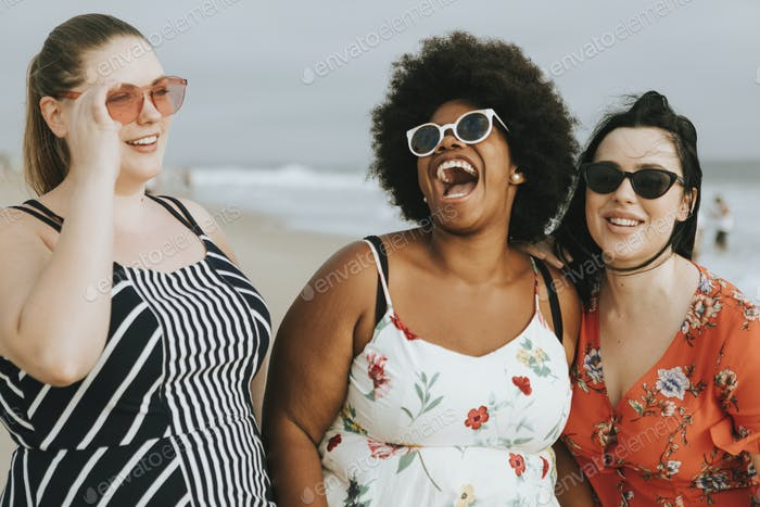 Cheerful diverse plus size women at the beach