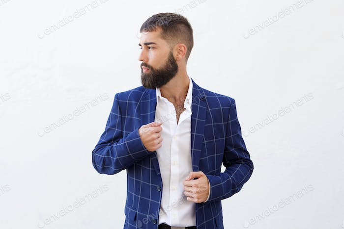 Handsome serious businessman in blue suit