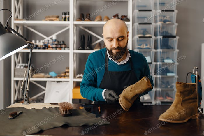 Shoemaker sharpens the shoe sole, footwear repair