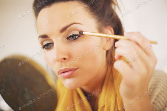 Woman Applying Makeup By Herself