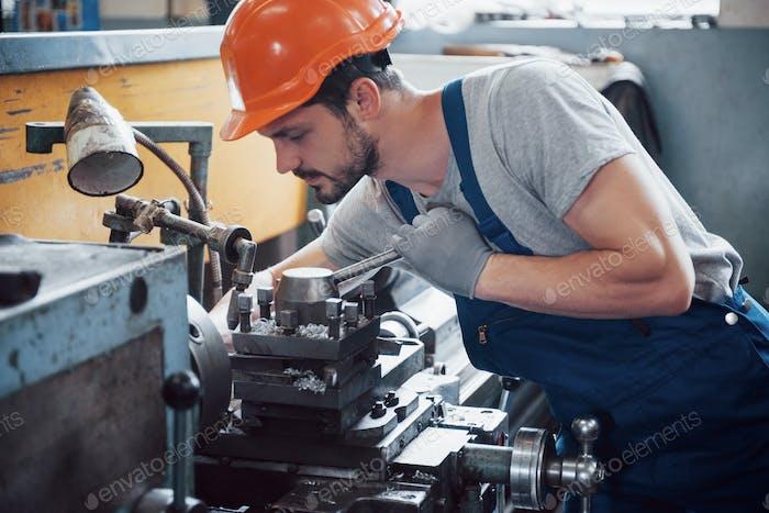 Experienced operator in a hard hat. Metalworking industry concept professional engineer metalworker