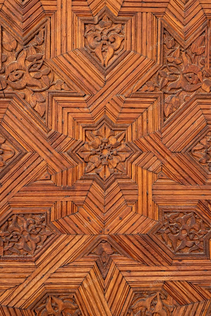 Arabic patterns on a wooden door in the Alhambra