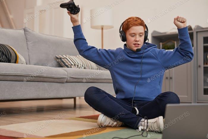 Emotional Boy Playing Video Games