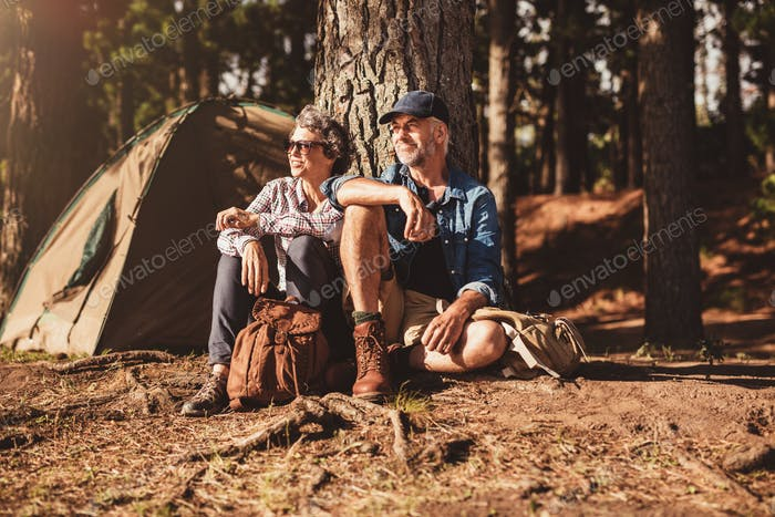 Mature couple relaxing at their campsite