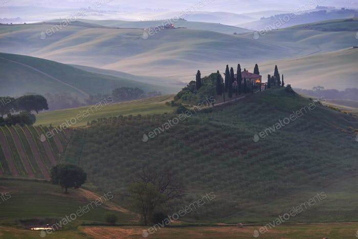 Farmhouse in Tuscany in the morning fog