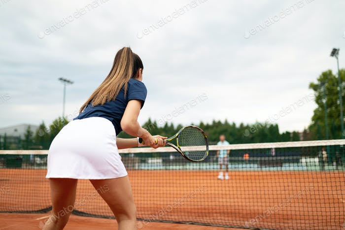 Happy fit girl playing tennis together. Sport concept