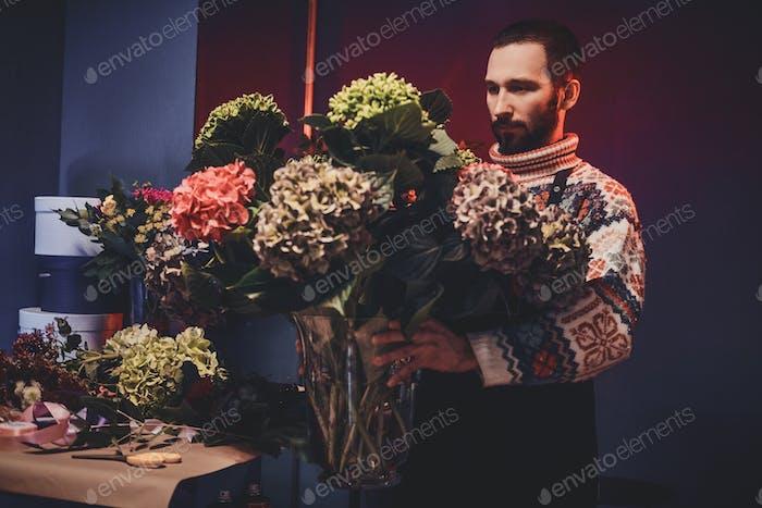Portrait of florist with beautiful bouquet