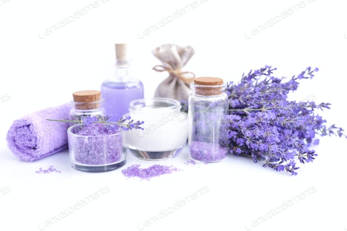 Spa composition with flowers of lavender, cream, salt and bottle