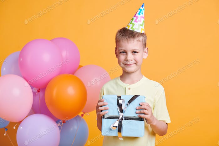 Cute smiling boy in t-shirt and birthday cap