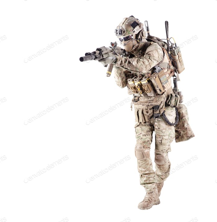 Equipped army soldier aiming rifle studio shoot
