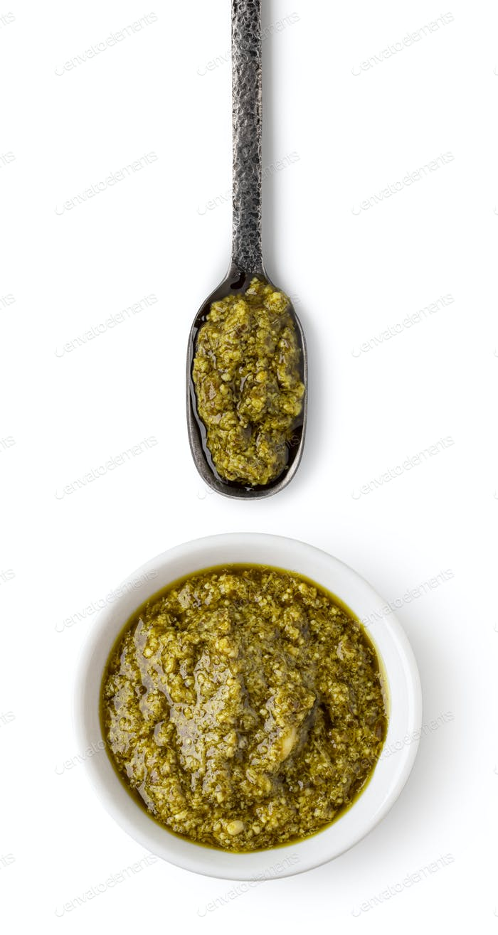 Bowl and spoon with pesto sauce