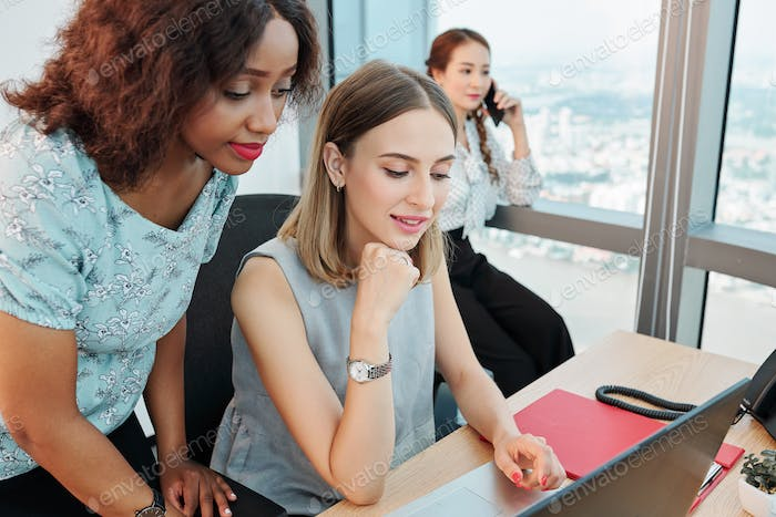 Businesswomen reading e-mail from client
