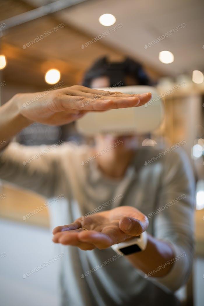 Man using virtual reality headset in restaurant