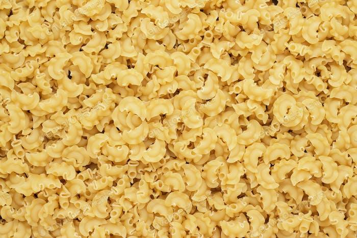 Dry Uncooked Creste Di Galli Pasta Texture Background