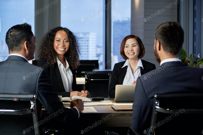 Multiethnic colleagues on business meeting