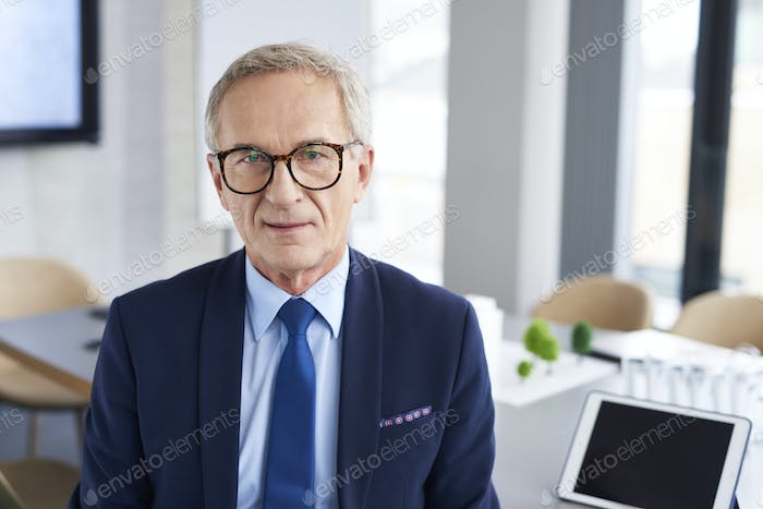Portrait of confident businessman in conference room