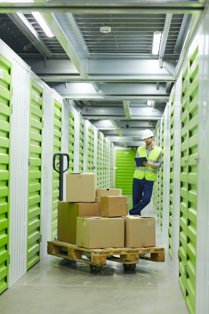 Man with a load in a warehouse