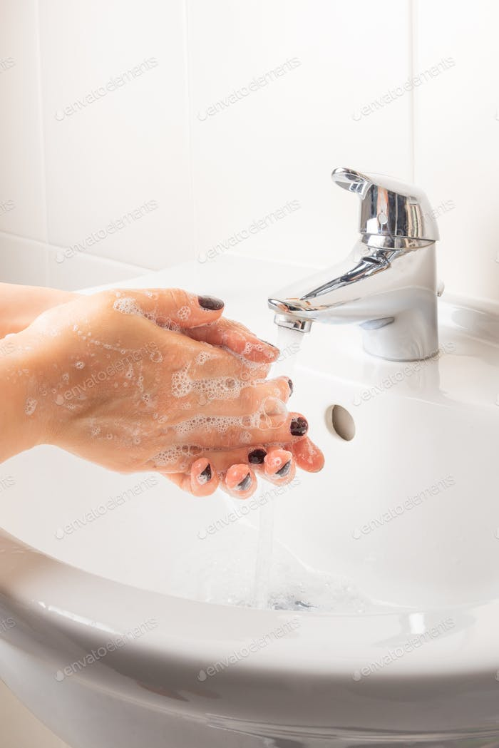 Woman is washing hands