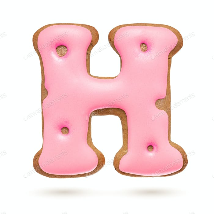 Capital letter H. Pink gingerbread biscuit isolated on white.