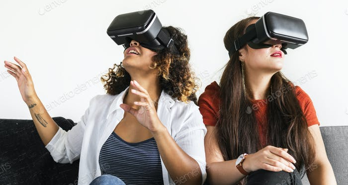 Women experiencing the virtual reality goggles