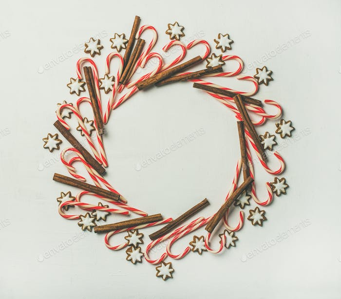 Christmas wreath pattern made from candy cane sticks and cinnamon