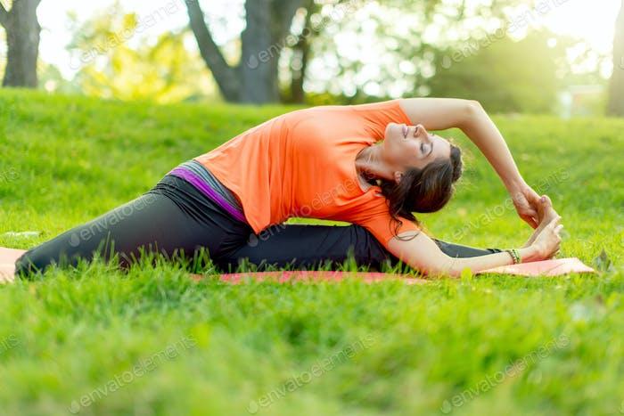 girl meditating and doing yoga at sunsets
