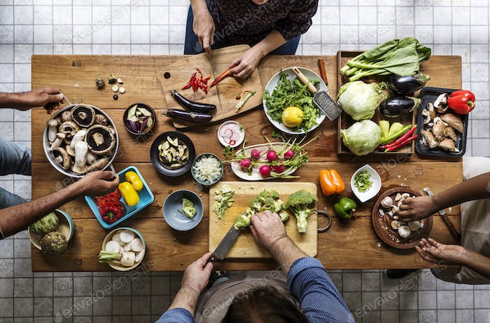 Aerial view of prople with fresh organic vegetable preparing to