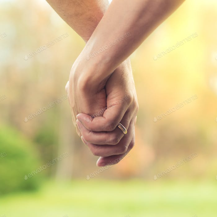 The concept of love between a man and a woman, traditional marriage, a couple holding hands