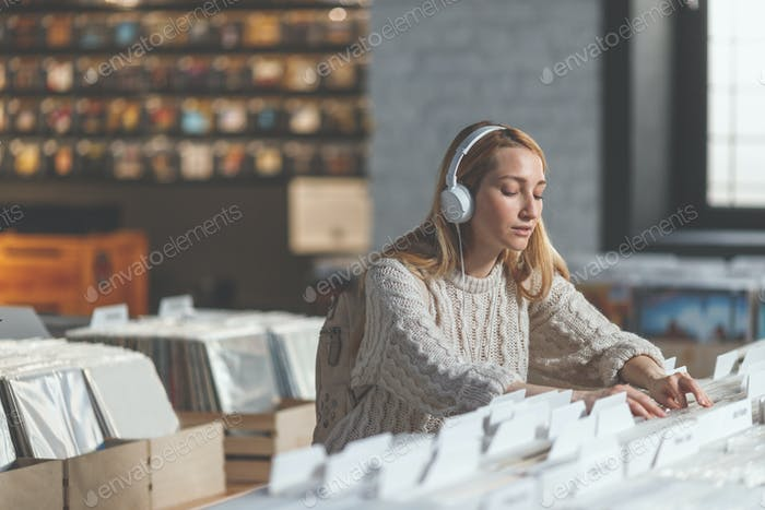 Attractive girl in a music store