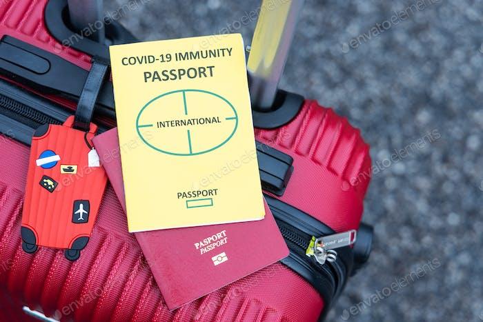 Conceptual Covid-19 Immunity Passport and travel passport on luggage