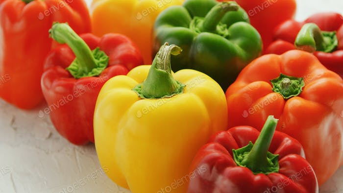 Multicolored bell peppers in heap