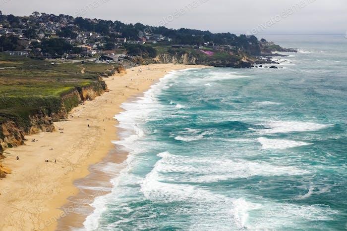 Aerial view of sandy beach in Montara, the Pacific Ocean coastline, California