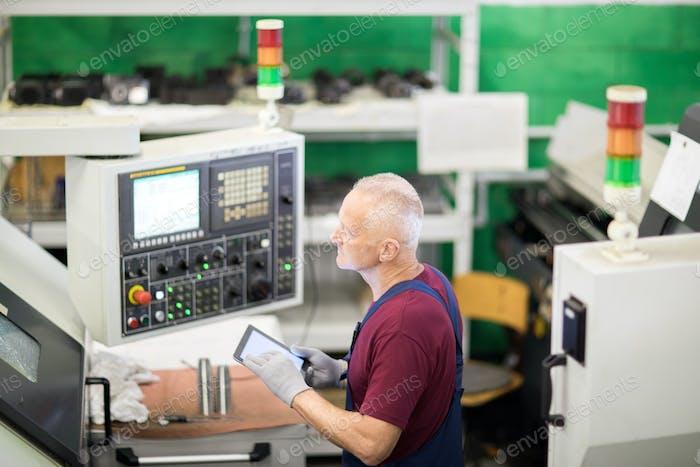 Engineer working with machine