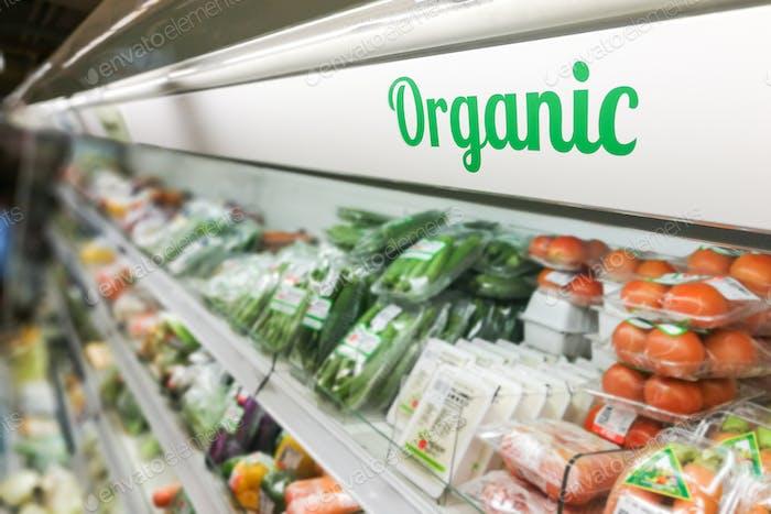 Organic food signage on modern supermarket fresh produce vegetab