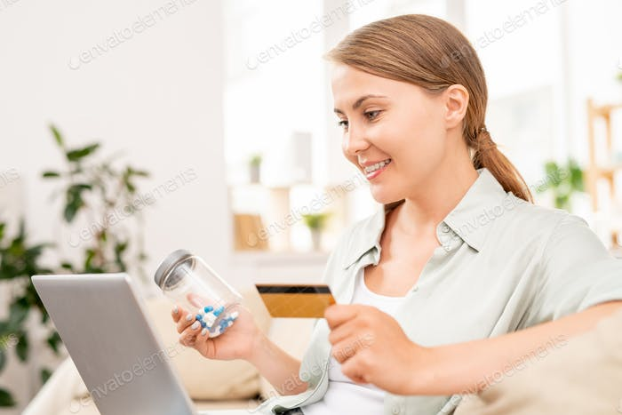 Happy girl looking through online drugstore for medicine