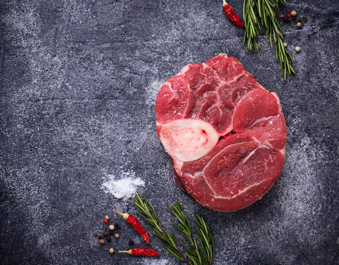 Raw meat osso buco with spices