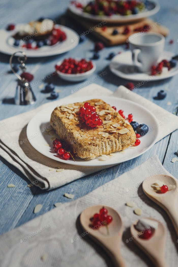 Pastry pie, tea, coffee and berries at blue rustic wood