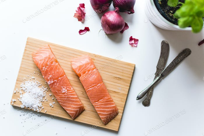 Raw salmon fillets prepared for cooking