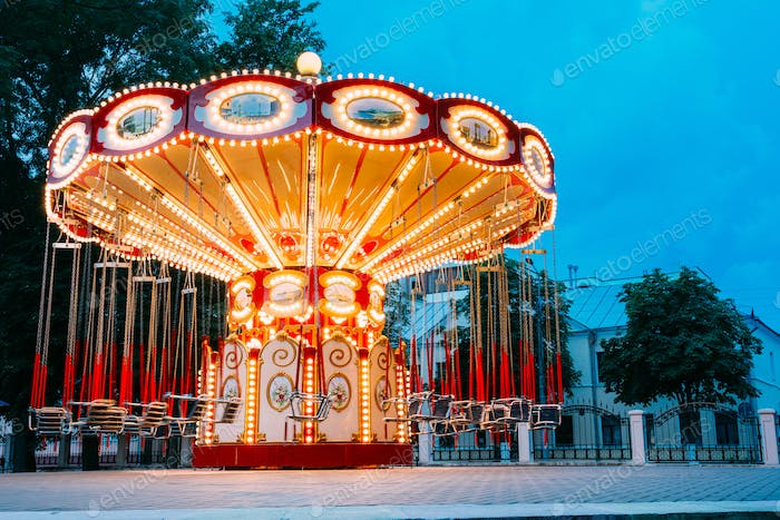 Brightly Illuminated Empty Carousel Merry-Go-Round. Nobody In Su