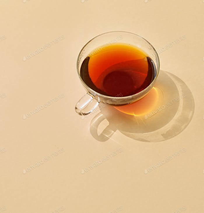 cup of tea with long shadow