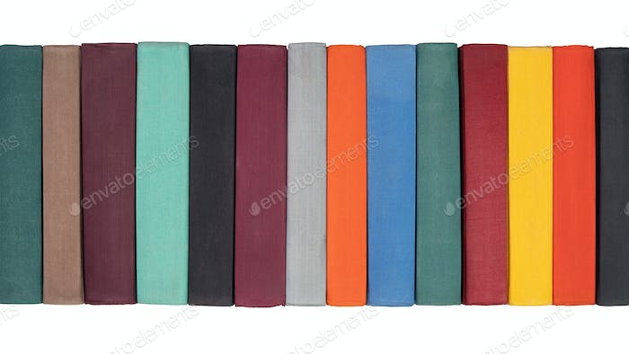 Stack of Old Hardcover Books on Bookshelf. Close-Up View of Multicolored Vintage Hardback Books