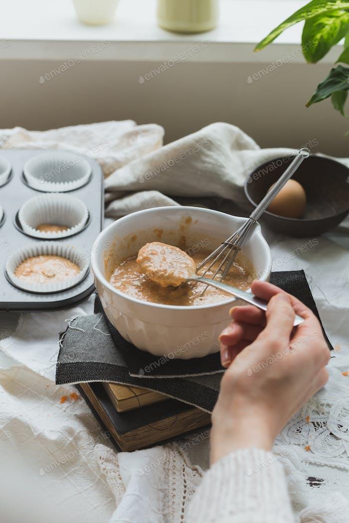 Carrot Cupcake Mixture in Bowl in Baking Scene