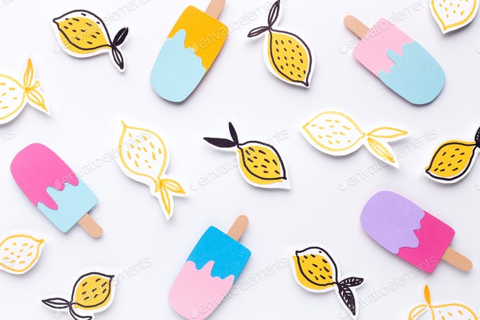 Creative wallpaper of ice cream and lemons on white