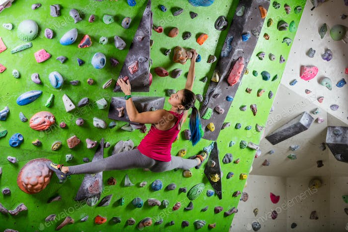 Thumbnail for oung woman bouldering in climbing gym