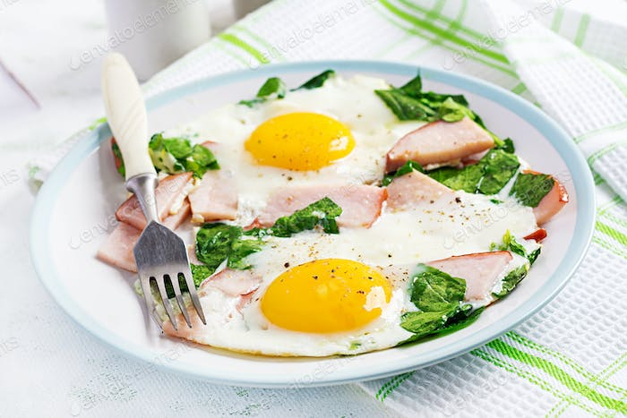 Fried eggs  with ham and spinach. Delicious English Breakfast. Brunch. Keto/paleo diet.