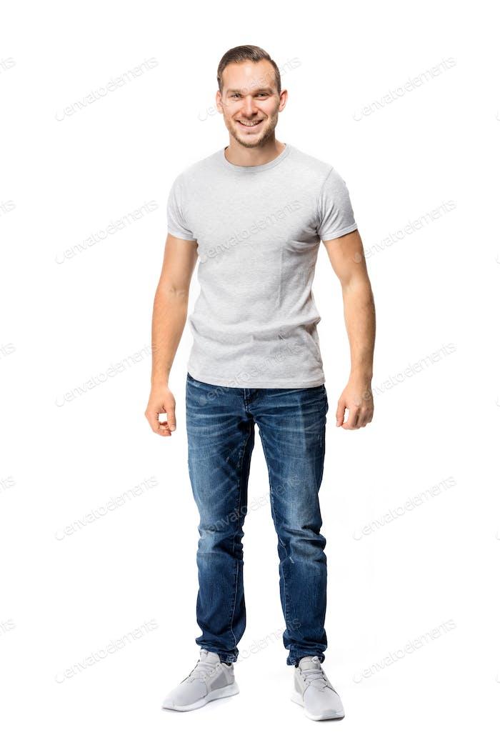 Handsome man in white t-shirt. Full body.