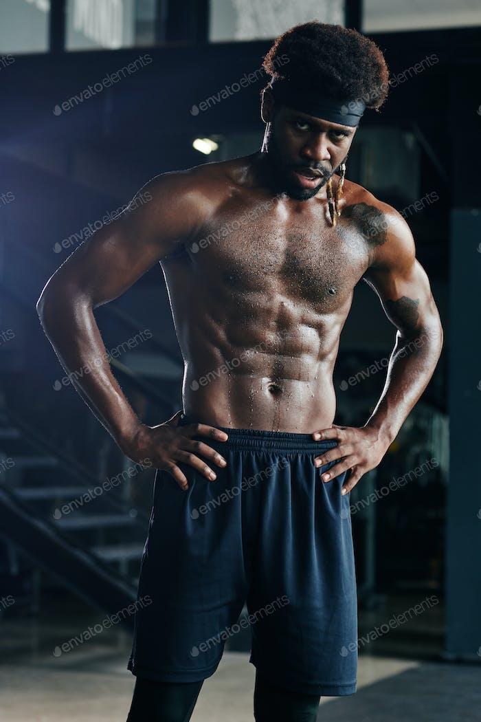 Swearty heavy breathing shirtless sportsman