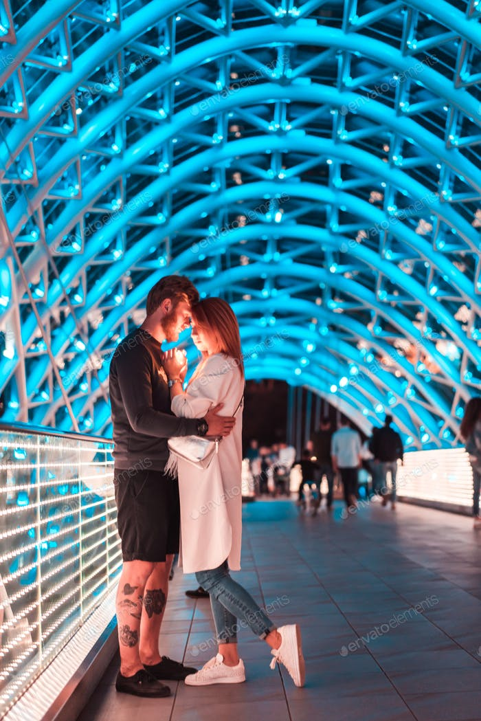 Loving couple on the bridge of Peace